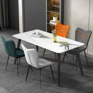 Bộ bàn ăn chân sắt mặt đá 4 ghế nệm simili nhập khẩu